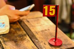Ordering number on table at a restaurant. Waiting for order in the restaurant. stock image