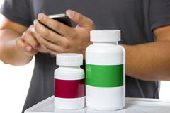 Ordering Supplements Online via Mobile Phone Royalty Free Stock Image