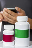 Ordering Supplements Online via Mobile Phone Stock Photo