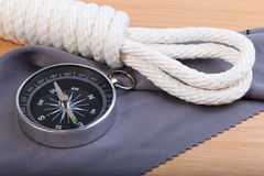 Orderliness white scout rope, compass and fabric. Stock Images