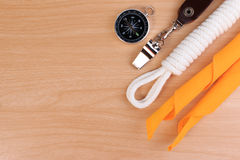 Orderliness white scout rope, scarf, whistle and compass. Royalty Free Stock Photo