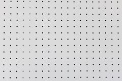 Free Orderly Dot Or Holes Rows And Columns On White Pegboard Wall Royalty Free Stock Photography - 148074737