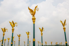 Orderly golden swan lamp on electricity in Thailand. Royalty Free Stock Photos