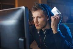 Orderly hacker stealing plastic money stock photos