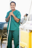 An Orderly Mopping The Floor In A Hospital Royalty Free Stock Photos