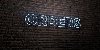 ORDERS -Realistic Neon Sign on Brick Wall background - 3D rendered royalty free stock image. Can be used for online banner ads and direct mailers Stock Photos