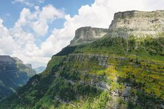 Ordesa canyon in Spanish Pyrenees. Wide view of the huge Ordesa canyon in Spanish Pyrenees. Majestic, deep mountain valley surrounded by vertical, orange walls royalty free stock image