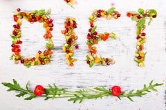 Ordet bantar göras från fruite och grönsaker Arkivfoton