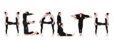 Ordet HÄLSA som bildas av gymnastkroppar Arkivbilder