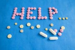 Ordet HJÄLP från preventivpillerar pills Medicin Royaltyfria Foton