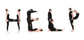Ordet HJÄLP som bildas av gymnastkroppar royaltyfri bild