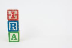 Ordet IRA i träbarns kvarter arkivfoton