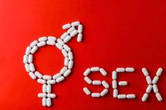 Ordet könsbestämmer med kapslar och preventivpillerar med behandlingar för erektil dysfunction Royaltyfria Foton