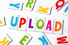 Ordet laddar upp gjort av färgrika bokstäver Fotografering för Bildbyråer