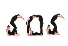 Ordet SOS som bildas av gymnastkroppar arkivbild
