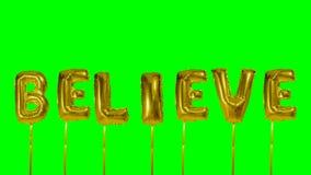 Ordet tror från guld- ballongbokstäver för helium som svävar på den gröna skärmen - arkivfilmer