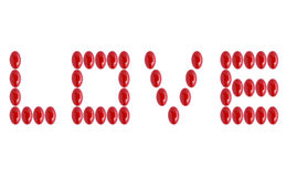 Ordförälskelse som göras med röda medicinpreventivpillerar Arkivfoto