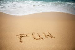 OrdGYCKEL i sand av stranden royaltyfria foton