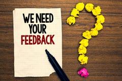 Ordhandstiltext behöver vi din återkoppling Affärsidéen för Give oss dina granskningtankar kommenterar vad för att förbättra skri royaltyfri fotografi