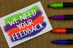 Ordhandstiltext behöver vi din återkoppling Affärsidéen för Give oss dina granskningtankar kommenterar vad för att förbättra färg royaltyfri foto