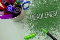 Ordhandstiltext rubricerar Motivational appell Affärsidéen för Heading av en artikel i tidning skrapade upptill tabellen Fotografering för Bildbyråer