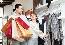 Ordinary adult couple choosing clothes Stock Image