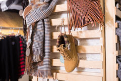 Ordinary apparel store. With different clothes on hangers Stock Images