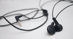 Ordinary black headphones. On a white background Stock Images