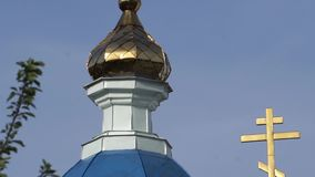 Ordinary church with gilding. Urban architecture in a provincial town.  stock footage