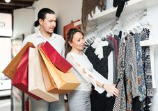 Ordinary couple choosing clothes Royalty Free Stock Photo