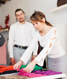 Ordinary couple choosing clothes at shop Royalty Free Stock Images