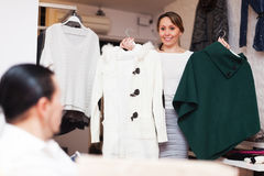 Ordinary couple choosing coat at shop Royalty Free Stock Images