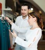 Ordinary couple at clothing shop Stock Photos