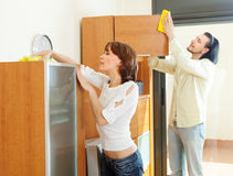 Ordinary couple dusting wooden furiture Stock Image