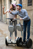 Ordinary couple going sightseeing by segways Royalty Free Stock Image