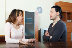Ordinary couple having serious talking Royalty Free Stock Images