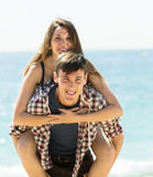 Ordinary couple on sandy beach Stock Images
