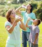 Ordinary  couple with teenager drinking water Stock Photo