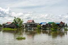 Ordinary day in floating village on Tonle Sap river near Phnom P stock photography
