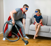 Ordinary day of superhero family. Royalty Free Stock Image