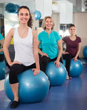 Ordinary different age women jumping on exercise ball Royalty Free Stock Photo