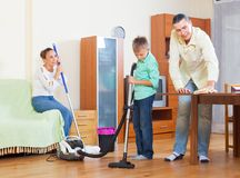 Ordinary family cleaning together Stock Photo