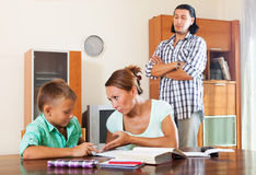 Ordinary family doing homework Royalty Free Stock Photos