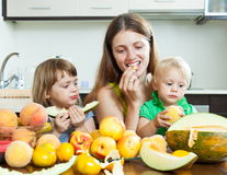 Ordinary family eating fruits Stock Image