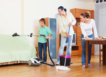 Ordinary family of three doing house cleaning Royalty Free Stock Image