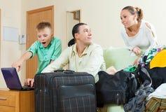 Ordinary family of three going on holiday Stock Photo