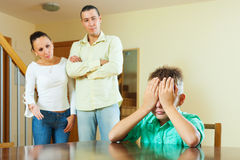 Ordinary family of three  having conflict. At home. Focus on boy Stock Image