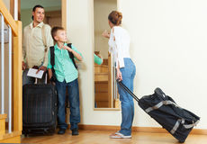 Ordinary family travelers  going on holiday. Ordinary family travelers with luggage  going on holiday Stock Photo