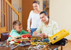 Ordinary family with working tools Stock Photo
