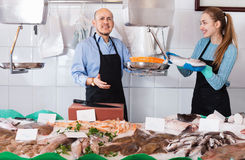 Ordinary fish and seafood store with two sellers Royalty Free Stock Photo